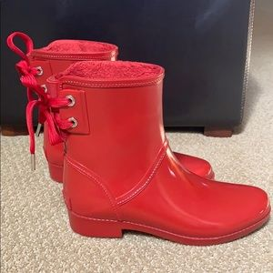 Red Michael Kors rain boots